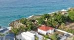 Срочная продажа! Невероятная возможность! Впечатляющий дом на берегу океана в Плайя Чикита в Сосуа!